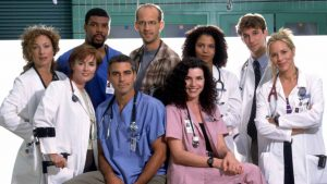 ER -- NBC Series -- TELECAST: Thursdays (10-11 p.m. ET) -- Pictured: (clockwise from left) Alex Kingston as Dr. Elizabeth Corday, Eriq La Salle as Dr. Peter Benton, Anthony Edwards as Dr. Mark Greene, Gloria Reuben as Physician Assistant Jeanie Boulet, Noah Wyle as Dr. John Carter, Maria Bello as Dr. Anna Del Amico, Julianna Margulies as Nurse Carol Hathaway, George Clooney as Dr. Doug Ross, Laura Innes as Dr. Kerry Weaver -- NBC Photo: Sven Arnstein