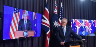 Британският премиер Борис Джонсън, австралийският премиер Скот Морисън и американският президент Джо Байдън по време на съвместна пресконференция чрез аудио -визуална връзка, Канбера, Австралия , 16 септември 2021г.